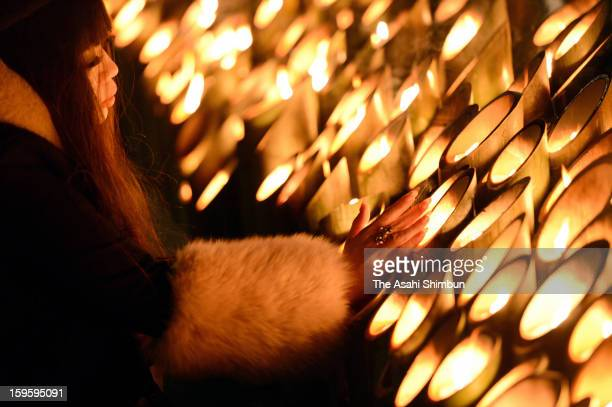A women prays for the victims of 1995's Great Hanshin Earthquake at Higashi Yuenchi park on January 17 2013 in Kobe Hyogo Japan Memorial services...