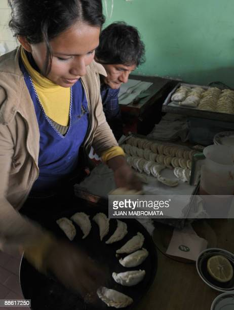 Women prepare empanadas at a typical eating place in Salta at the foothills of the Andes mountain range in the Argentine northern province of Salta...