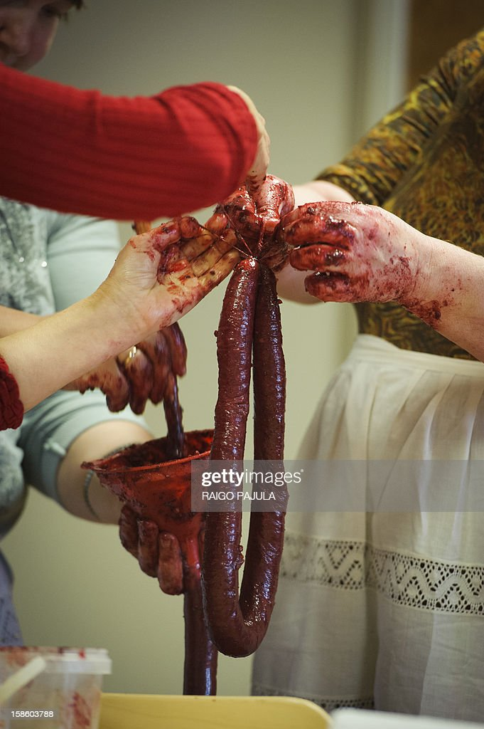 Women prepare Estonian blood sausages in Tallinn, Estonia, on December 15, 2012. As Christmas looms, residents of the Baltic state of Estonia are bracing to wolf down tonnes of blood sausage, a staple of their holiday table.