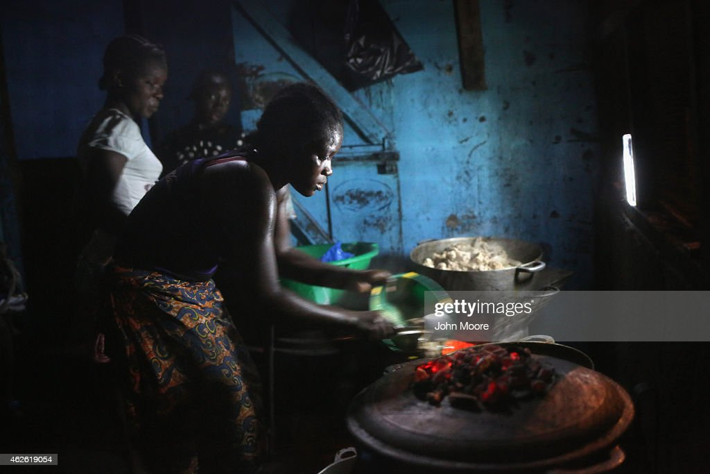 Women prepare meals at the SisKMa Food Center on January 31 2015 in the West Point township of Monrovia Liberia Life has slowly begun to return to...