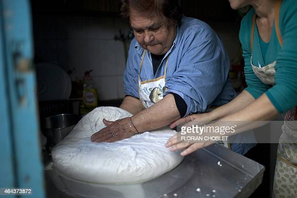 Women prepare traditional halloumi cheese at a house in the Cypriot village of Astromeritis located some 30 km west of the capital Nicosia on the...