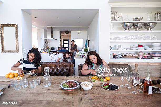 Women preparing dinner in large home