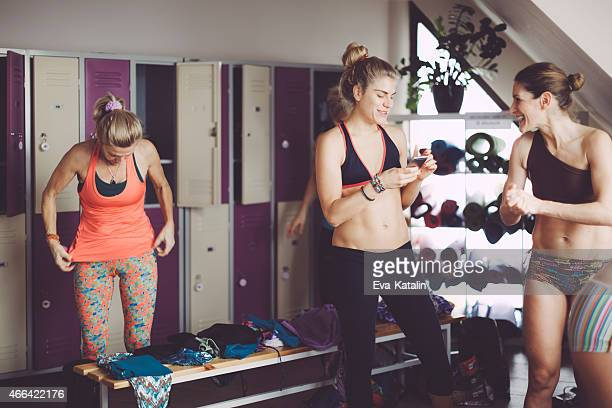 Women preparing for yoga in the dressing room