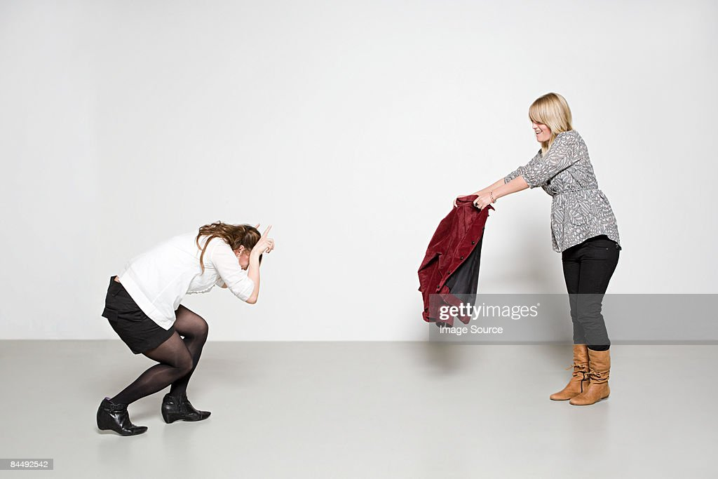 Women pretending to be bull and bullfighter : Stockfoto