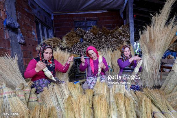 Women produce brooms at Alibeyli village of Carsamba district in Samsun Turkey on October 18 2017 The village dwellers who learn making brooms from...