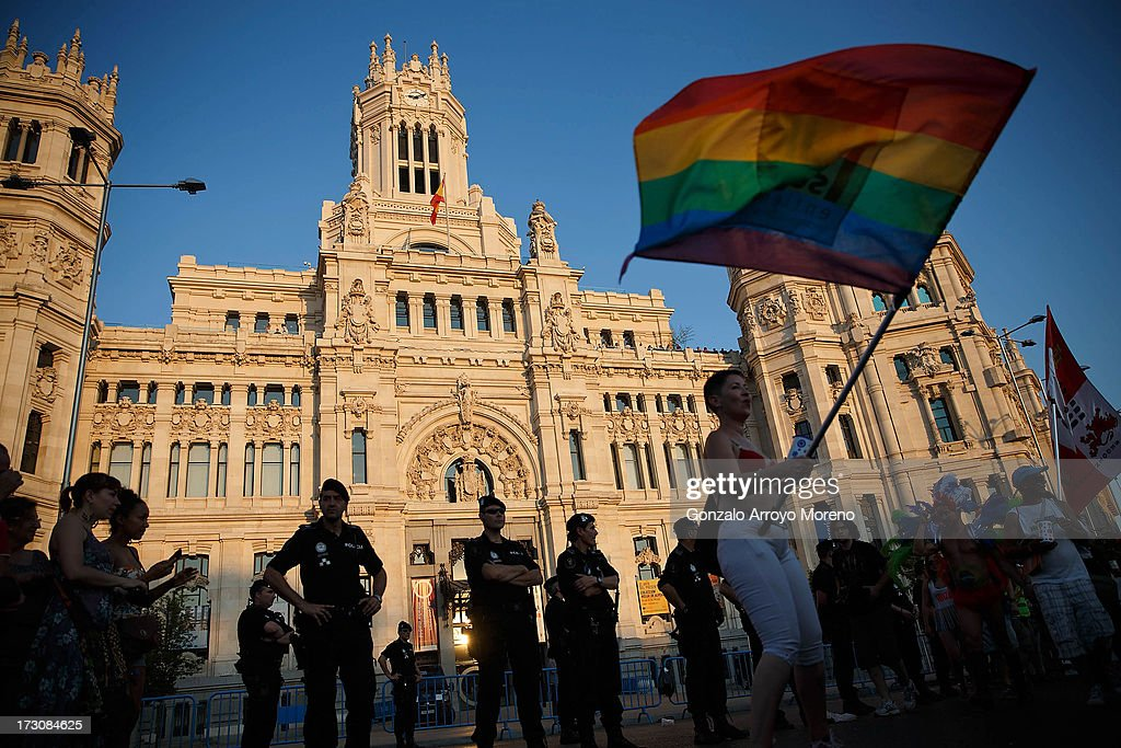 Women protest in front of Madrid City Council surrounded by municipal police during the Madrid Gay Pride Parade 2013 on July 6, 2013 in Madrid, Spain. This year the Madrid Gay Pride Parade route was changed by the authorities to the annoyance of Gay Pride Parade supporters. According to a new Pew Research Center survey about homosexual acceptance around the world, Spain tops gay-friendly countries with an 88 percent acceptance rate.