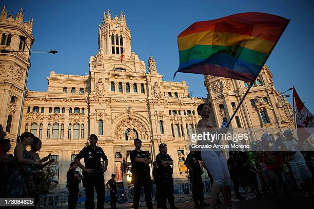 Women protest in front of Madrid City Council surrounded by municipal police during the Madrid Gay Pride Parade 2013 on July 6 2013 in Madrid Spain...