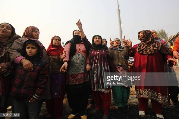 Women protesters raise slogans against Indian forces after a 16 year old youth Rizwan Mir who was injured during a road accident by an Indian...