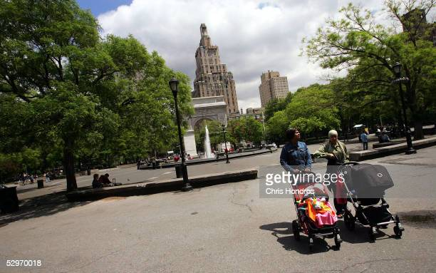 Women push strollers through Washington Square Park May 23 2005 in New York City A renovation is planned for the Greenwich Village park which...