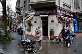 Women pushing baby carriages in front of a Albanian pub in Sonnenallee in Neukoelln district on November 02 2013 in Berlin Germany The pub is named...