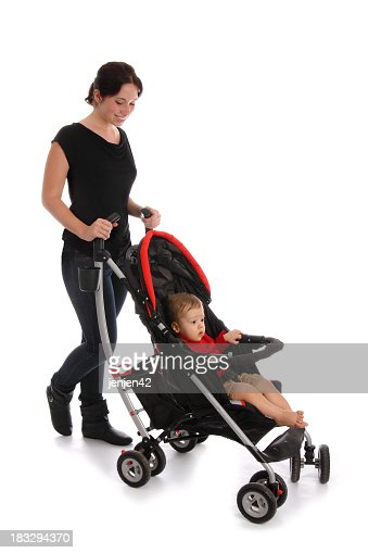 Women pushing child in stroller