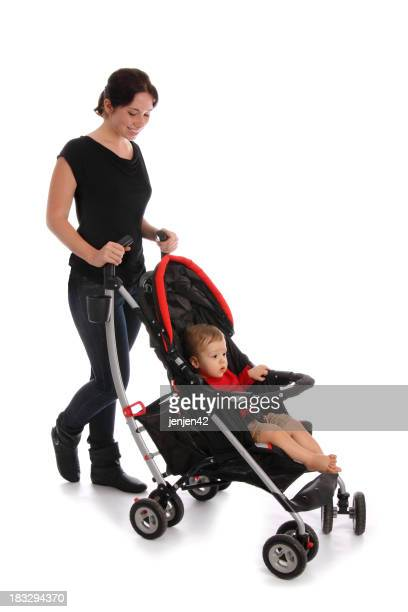 Women pushing child in stroller
