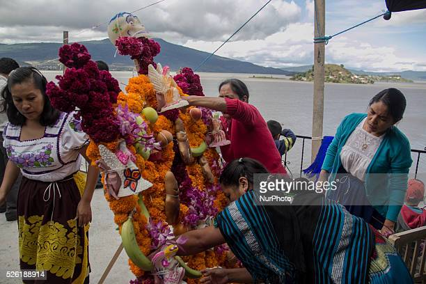 Women put offerings of fruit bread and sweet to their dead in the flower arrangement Janitzio October 31 2015