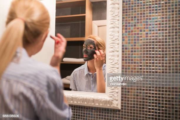 Women putting mask on face