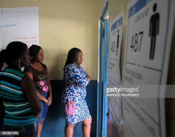 Women queue at a polling station in Guayaquil Ecuador on February 19 2017 during general elections Ecuador's elections will decide who succeeds...