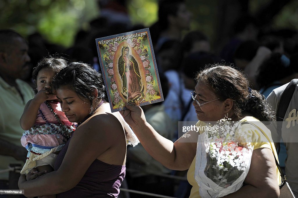 Women queue to venerate the Virgin of Guadalupe at the Basilica de Guadalupe in San Salvador on December 12, 2012. Salvadorean faithfuls celebrated the appearance of the Virgin of Guadalupe to Juan Diego in 1531. AFP PHOTO/ Jose CABEZAS