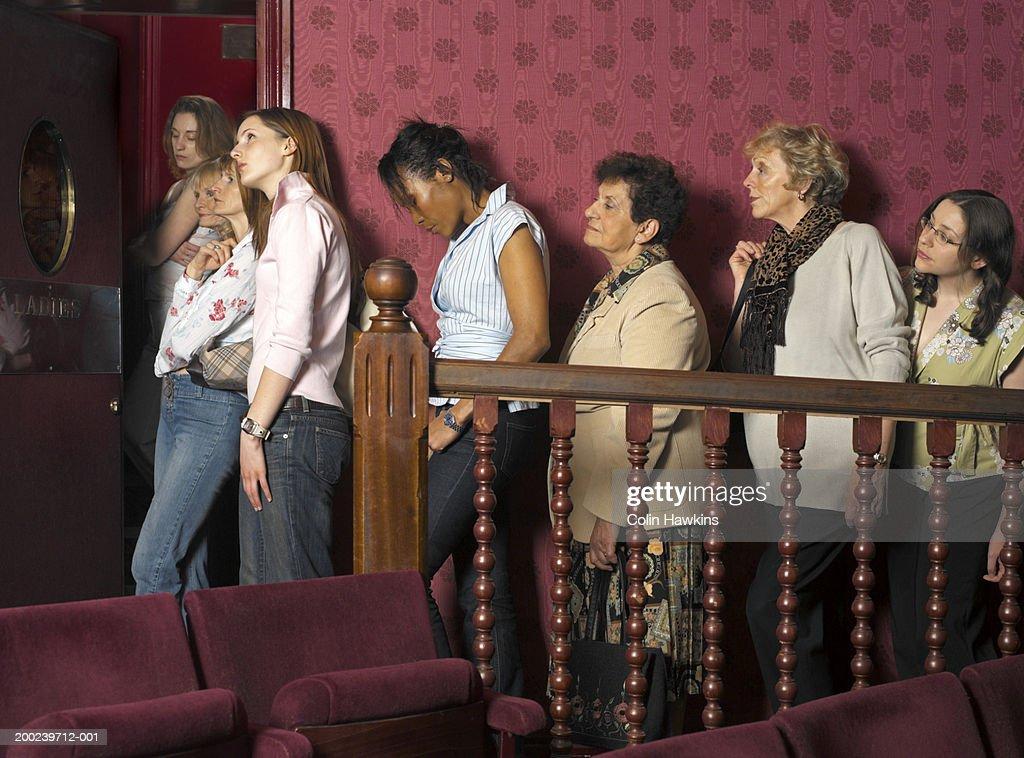 Women queuing for theatre bathroom : Stock Photo