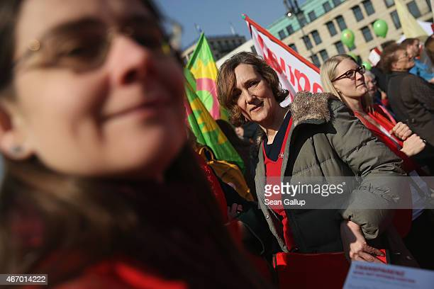 Women rally for equal pay for women compared to men on Equal Pay Day on March 20 2015 in Berlin Germany Income for women still lags behind that of...