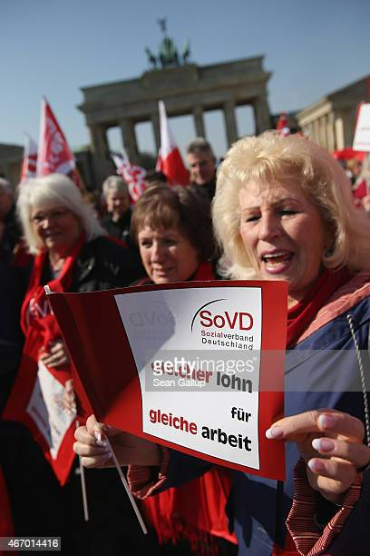 Women rally for equal pay for women compared to men on Equal Pay Day in front of the Brandenburg Gate on March 20 2015 in Berlin Germany Income for...