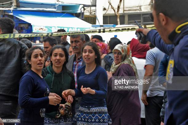 Women react near the site of an explosion at the police headquarters in Diyarbakir southeastern Turkey on April 11 2017 The explosion which shook...