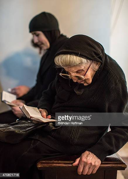 Women read books of prayers inside Etchmiadzin Cathedral which is the mother church of the Armenian Apostolic Church and is considered the oldest...