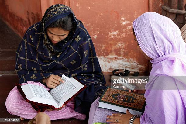 Women reading the Quran at Jamma Masjid