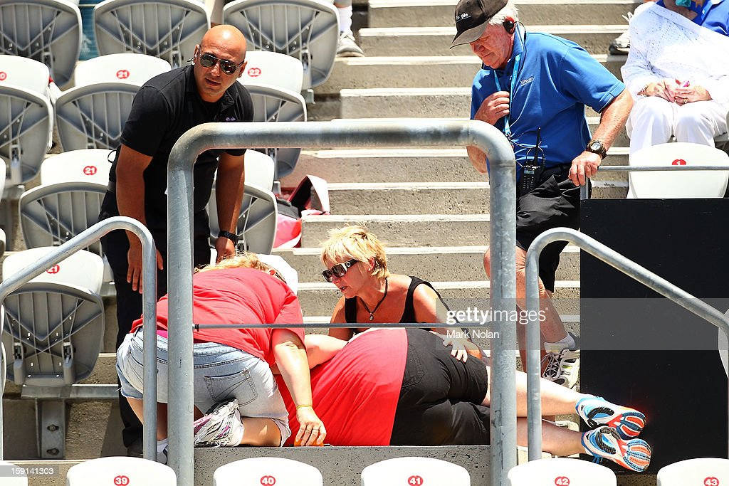 A women receives attention after falling down the stairs during the quaterfinal match between Roberta Vinci of Italy and Agnieszka Radwanska of Poland on day four of the Sydney International at Sydney Olympic Park Tennis Centre on January 9, 2013 in Sydney, Australia.