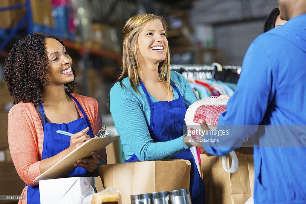 Women receiving donated turkeys at food bank