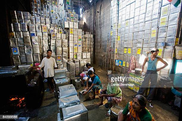 Women recycle onegallon cooking oil cans in the Dharavi slum on February 3 2009 in Mumbai India The redevelopment of the Jari Mari slum situated near...