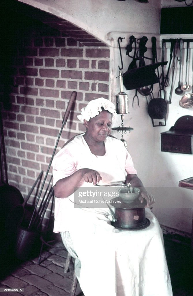 A women reenacts daily life in Colonial Williamsburg, Virginia. A living history of life in circa 1700's.