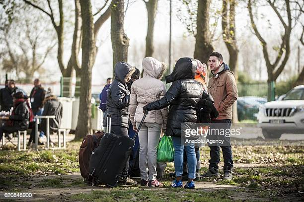 Women Refugees are waiting with their luggages to climb into a bus after leaving the 'Jules Ferry' center reception in Calais on November 3 2016 Over...