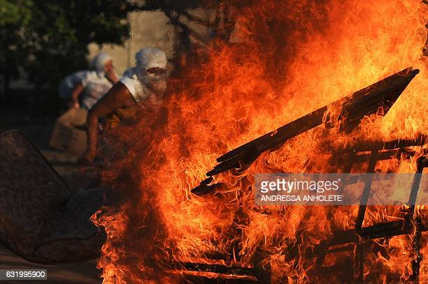 Women relatives of inmates set makeshift barricades on fire in protest for the transfer of some 200 prisoners from the Alcacuz Penitentiary Center...