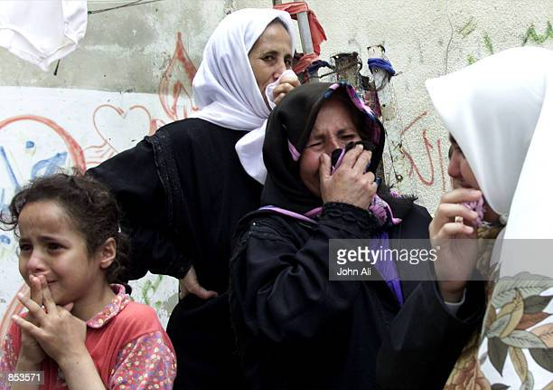 Women relatives of Kamel elJamel a 21yearold of Palestianian police officer weep in front of his home as they wait for his body before the funeral...