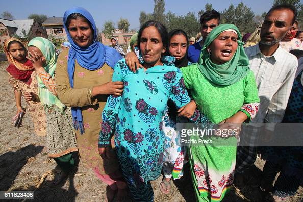 Women relatives wail over the killing of Muzaffar Ahmad Pandit during his funeral procession Checkekawoosa in central Kashmirs Buddgam district in...
