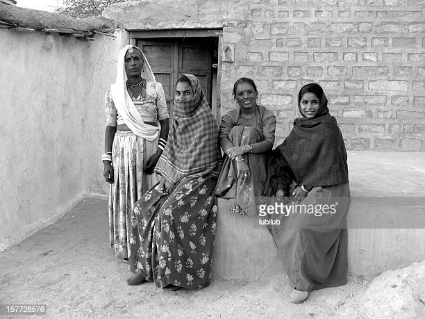 Women relaxing by a house in village Chandelao, Rajasthan, India