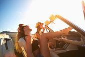 Women relaxing in convertible outdoors
