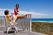 Women relaxing on balcony