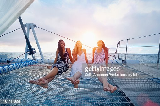 Women relaxing on boat in ocean