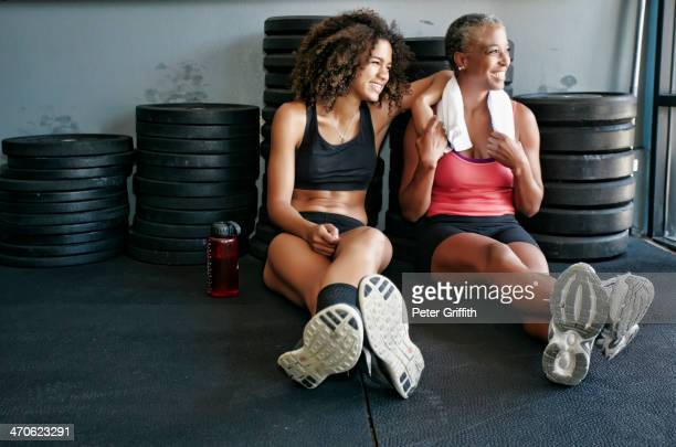 Women relaxing together in gym