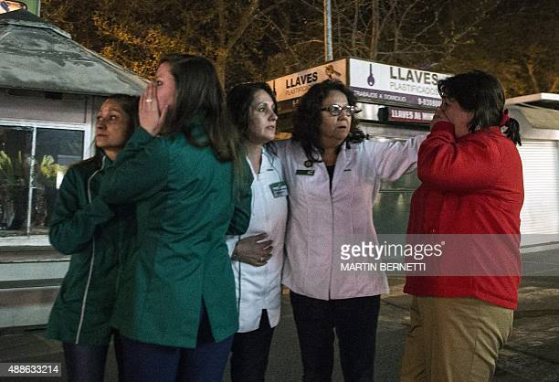 Women remain at a street during a strong quake in Santiago on September 16 2015 A strong 72magnitude earthquake struck the center of Chile on...