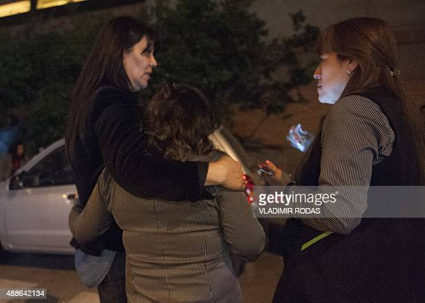 Women remain outside a building during a strong quake in Santiago on September 16 2015 A strong 72magnitude earthquake struck the center of Chile on...