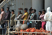 Women rescued at sea arrive aboard the Italian Navy ship 'Vega' on May 29 2016 in the port of Reggio Calabria southern Italy A week of shipwrecks and...