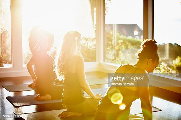 Women resting between poses in yoga class