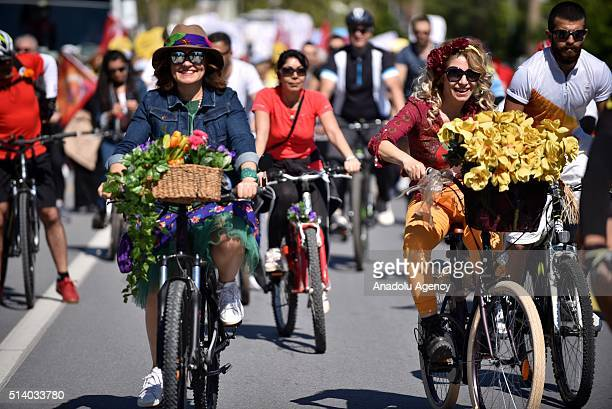 Women ride bicycles during the International Women's Day celebrations as they protest the violence against women in Mersin Turkey on March 6 2016