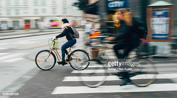 Women riding bicycles in the street