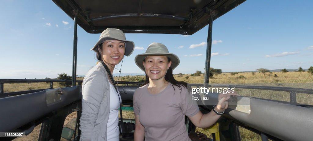 Women riding in truck on safari : Stock Photo