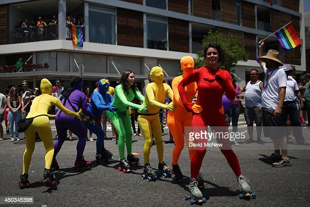 Women roller skate in rainbowcolored body suits in the LA Pride Parade on June 8 2014 in West Hollywood California The LA Pride Parade and weekend...