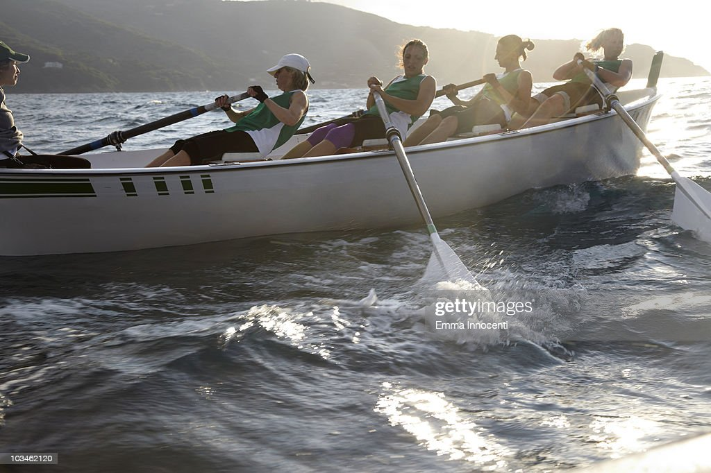 women rowing fast : Stock Photo