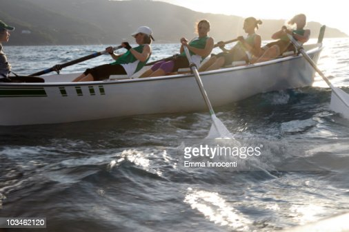 women rowing fast