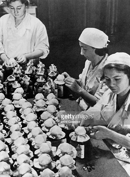 Women sealing flasks of donated blood World War II Moscow 1941 Thousands of Moscow citizens responded to appeals to donate blood as the Germans...